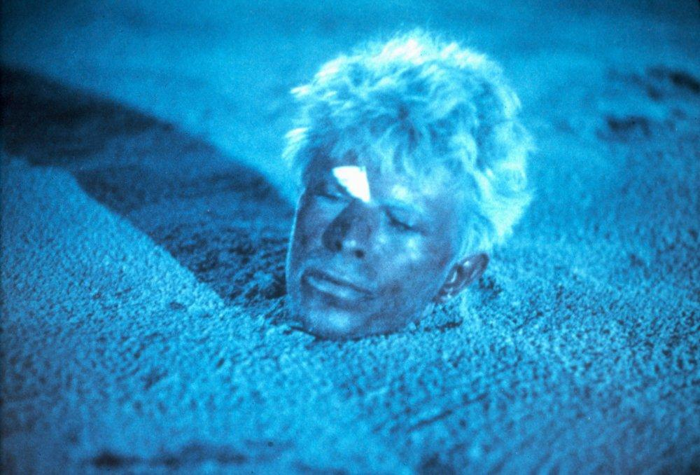 merry-christmas-mr-lawrence-1982-003-bowie-in-blue-tinted-sand-00o-1w8.jpg